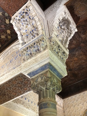 intricately decorated marble and stucco column, with lapis