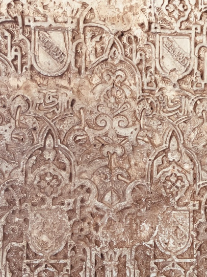 Side by side you see where Christians replaced Islamic stucco with a heraldic crest