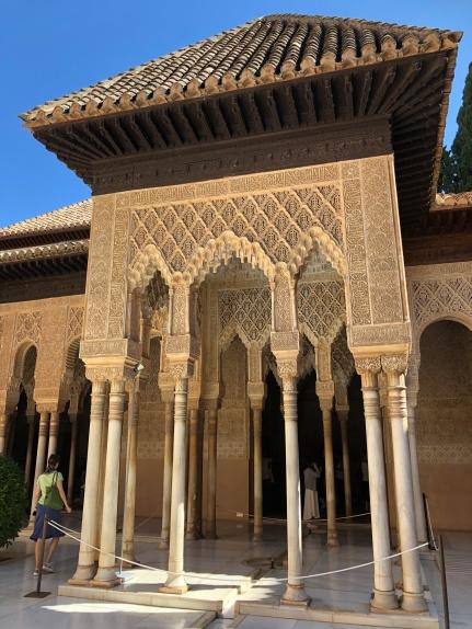 The elegant portico on one side of the Patio de Leones