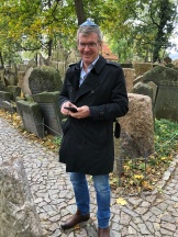 Ross in the cemetery with his kippah