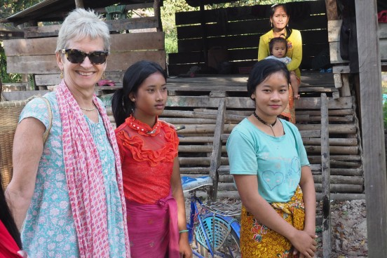 Being shown round the village by girls about to return to the fields