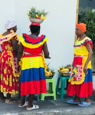 These fruit sellers are everywhere but hate having photos taken. Slave style dresses.