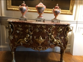 Sevres pottery on top of the ornate cabinet